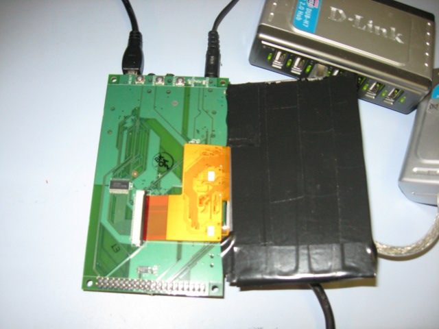 Display connected to Palo baseboard.  Note the tape applied to the display to keep from shorting to components on baseboard.